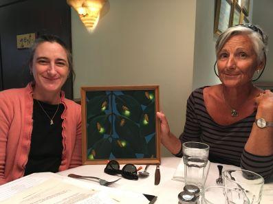 Cate & Susan Hibbitt display the original painting.